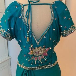 Delicate teal and pink sari with jeweled detail